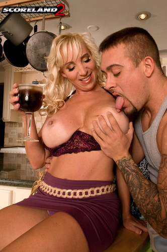 Anika Anderssen – Busty  Mature Table top titillation